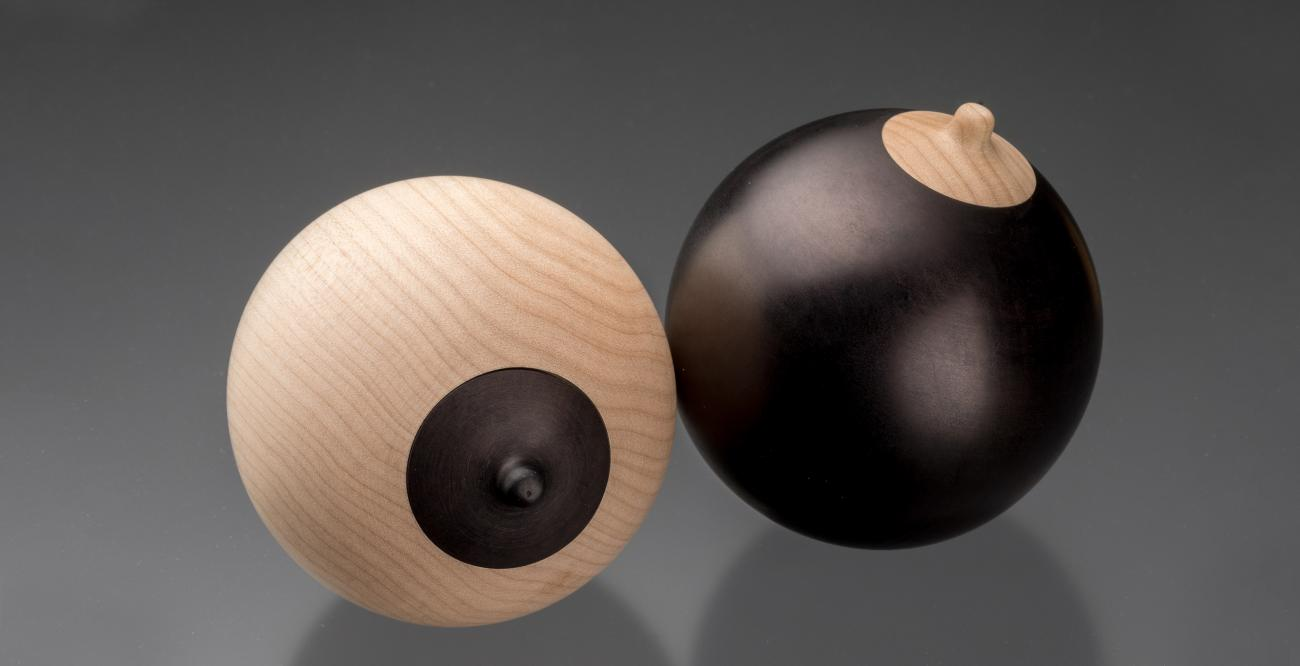 2 breast shaped wooden boxes