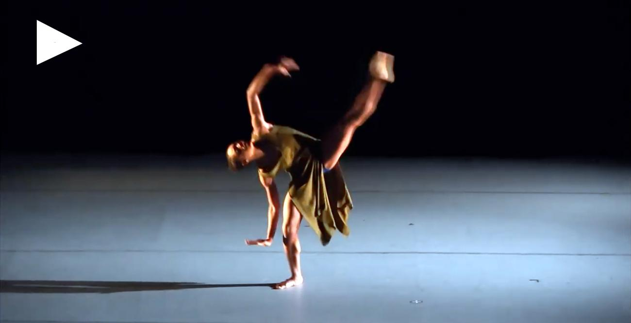 Dancer on stage with extended leg