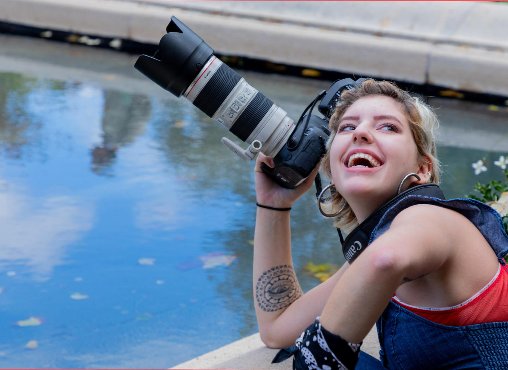 UArts students smiles with a camera in hand